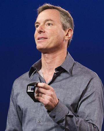 "Paul Jacobs, chairman and CEO of Qualcomm, displays the new ""Toq"" smartwatch at the Uplinq 2013 conference in San Diego, California, September 4, 2013. REUTERS/Fred Greaves/Files"