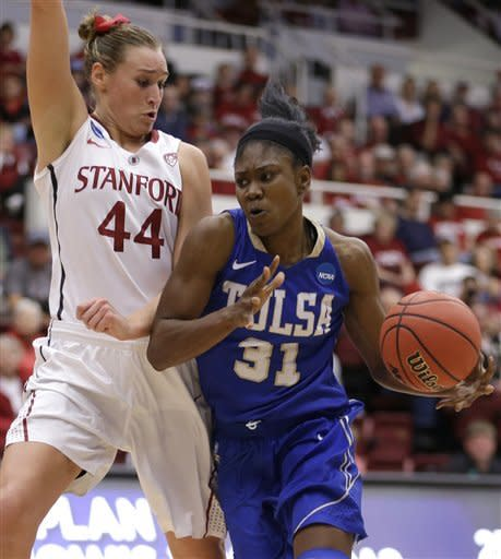 Tulsa's Tiffani Couisnard, right, drives the ball against Stanford's Joslyn Tinkle (44) during the first half of a first-round game in the women's NCAA college basketball tournament on Sunday March 24, 2013, in Stanford, Calif. (AP Photo/Ben Margot)