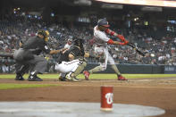 Washington Nationals center fielder Victor Robles (16) hits an RBI single against the Washington Nationals during the second inning of a baseball game Saturday, May 15, 2021, in Phoenix. (AP Photo/Rick Scuteri)