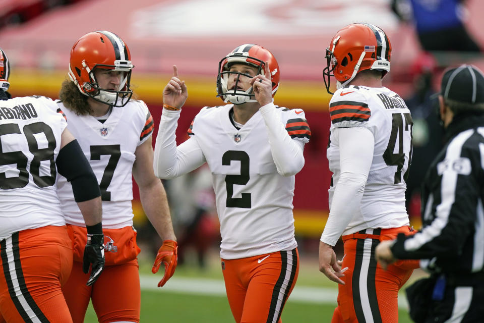 FILE - Cleveland Browns place kicker Cody Parkey (2) celebrates after kicking a 46-yard field goal during the first half of an NFL divisional round football game against the Kansas City Chiefs in Kansas City, in this Sunday, Jan. 17, 2021, file photo. Parkey agreed to re-sign with Cleveland on Friday, March 19, 2021, returning to the team after beginning last season on the practice squad.(AP Photo/Charlie Riedel, File)