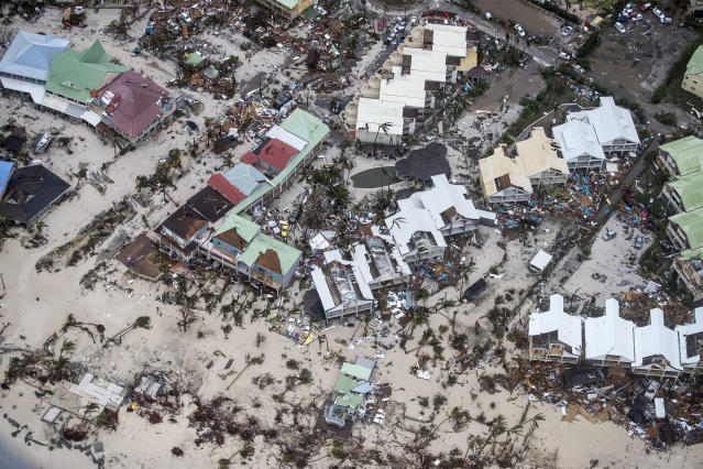 <p>This Sept. 6, 2017 photo provided by the Dutch Defense Ministry shows storm damage in the aftermath of Hurricane Irma, in St. Maarten. Irma cut a path of devastation across the northern Caribbean, leaving thousands homeless after destroying buildings and uprooting trees. Significant damage was reported on the island that is split between French and Dutch control. (Photo: Gerben Van Es/Dutch Defense Ministry via AP) </p>