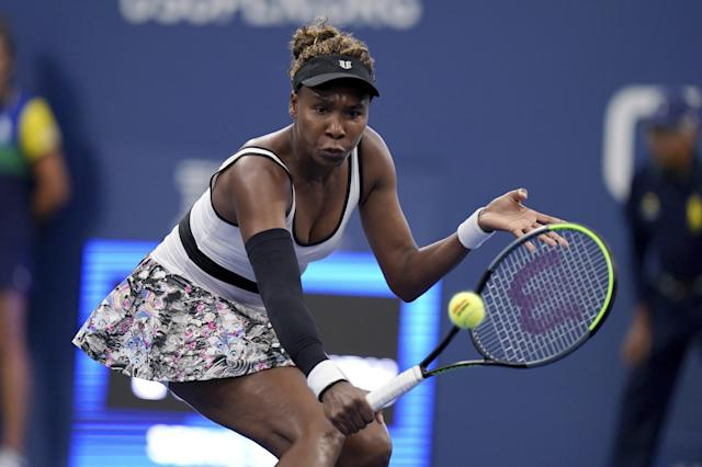 Venus Williams, of the United States, returns a shot to Elina Svitolina, of Ukraine, during the second round of the US Open tennis championships Wednesday, Aug. 28, 2019, in New York. (AP Photo/Michael Owens)