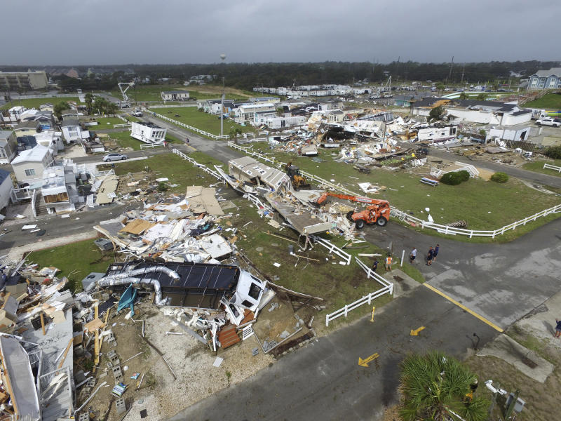 Emerald Isle town employees work to clear the road after a tornado hit Emerald Isle N.C. as Hurricane Dorian moved up the East coast on Thursday, Sept. 5, 2019. (Photo: Tom Copeland/AP)