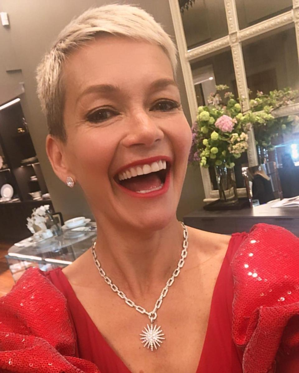 Jess Rowe wearing a red dress and silver star necklace