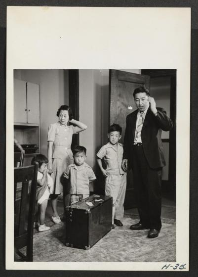 Mr. and Mrs. Oshima and their three small children, all recently arrived from the Tule Lake Relocation Center