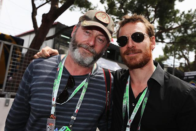MONTE CARLO, MONACO - MAY 27: (L-R) Actors Liam Cunningham and Michael Fassbender are seen on the grid before the Monaco Formula One Grand Prix at the Circuit de Monaco on May 27, 2012 in Monte Carlo, Monaco. (Photo by Mark Thompson/Getty Images)