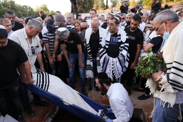 Family and friends in Moshav Hadid, Israel, mourn during the funeral Tuesday of Yigal Yehoshua, an Israeli man who died of wounds sustained during Arab-Jewish violence in the mixed city of Lod.