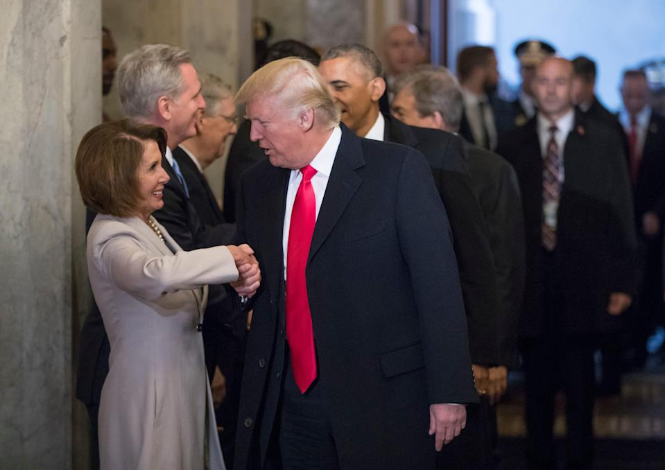 In this 2017 photo, then-President-elect Donald Trump greets House Democratic leader Nancy Pelosi.