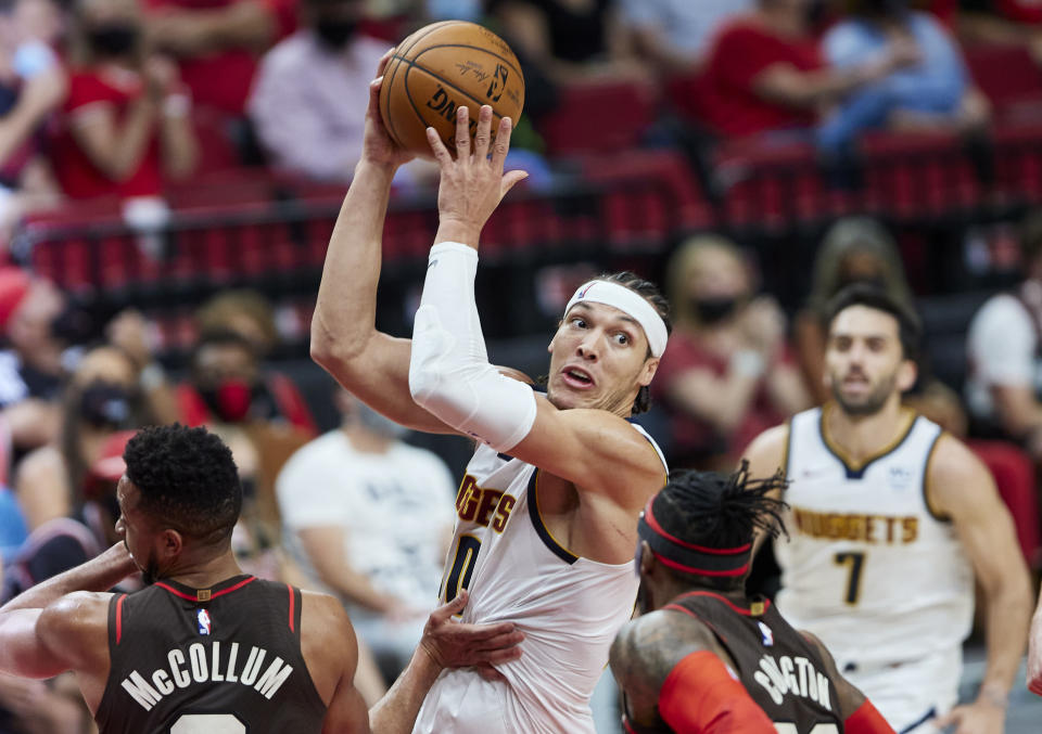 Denver Nuggets forward Aaron Gordon looks to pass against the Portland Trail Blazers during the first half of Game 6 of an NBA basketball first-round playoff series Thursday, June 3, 2021, in Portland, Ore. (AP Photo/Craig Mitchelldyer)