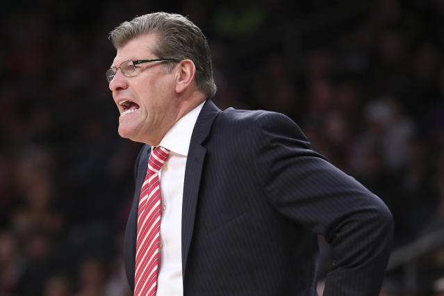 Connecticut head coach Geno Auriemma directs his players from the bench during the first half of an NCAA college basketball game against California as part of the Maggie Dixon Basketball Classic at Madison Square Garden, Sunday, Dec. 22, 2013, in New York. (AP Photo/John Minchillo)