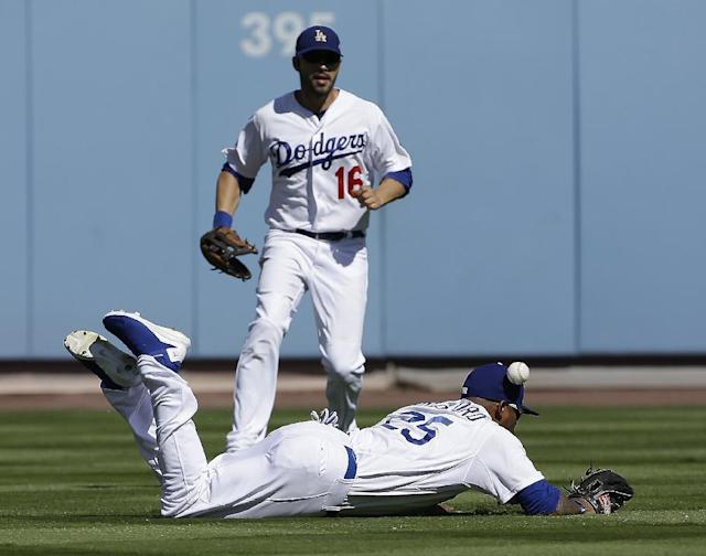 Los Angeles Dodgers' Carl Crawford (25) can't catch a single hit by St. Louis Cardinals' Matt Holliday during the first inning of Game 5 of the National League baseball championship series Wednesday, Oct. 16, 2013, in Los Angeles. (AP Photo/David J. Phillip)