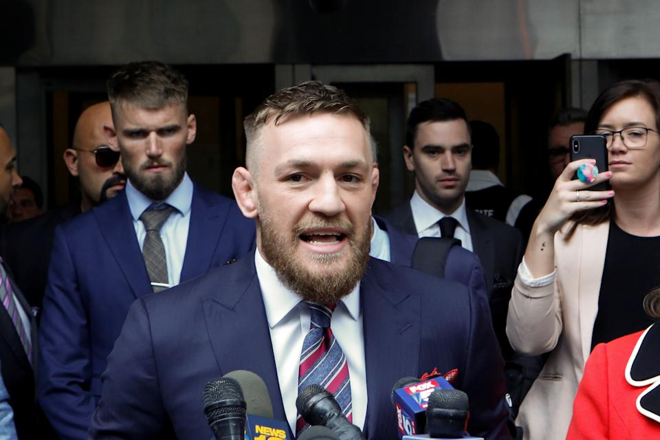 Mixed martial arts (MMA) fighter Conor McGregor speaks to the media as he exits the court after appearing in the Brooklyn court on charges of assault stemming from a melee, in the Brooklyn borough of New York City, U.S., July 26, 2018. REUTERS/Eduardo Munoz