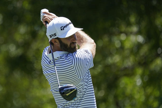 Dustin Johnson watches his tee shot on the 14th hole during practice for the Charles Schwab Challenge golf tournament at the Colonial Country Club in Fort Worth, Texas, Wednesday, June 10, 2020. (AP Photo/David J. Phillip)