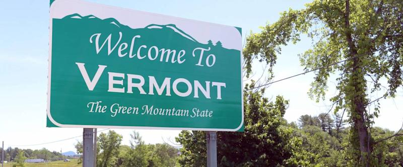 A welcome sign at the Vermont state line.