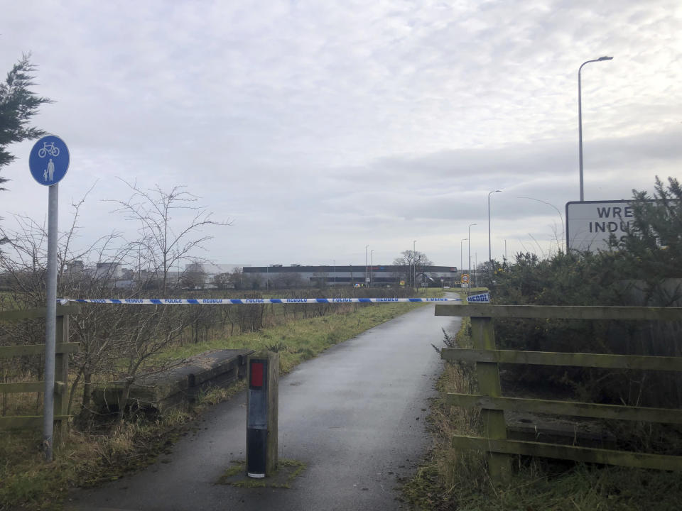 A police cordon at Wrexham Industrial Estate near the British pharmaceutical manufacturing company Wockhardt in Wrexham, north Wales, Wednesday Jan. 27, 2021. Wockhardt UK, an arm of the Mumbai-based pharmaceutical company that is producing the Oxford-AstraZeneca vaccine in north Wales, said it notified authorities after receiving a suspect package on Wednesday morning. (Eleanor Barlow/PA via AP)