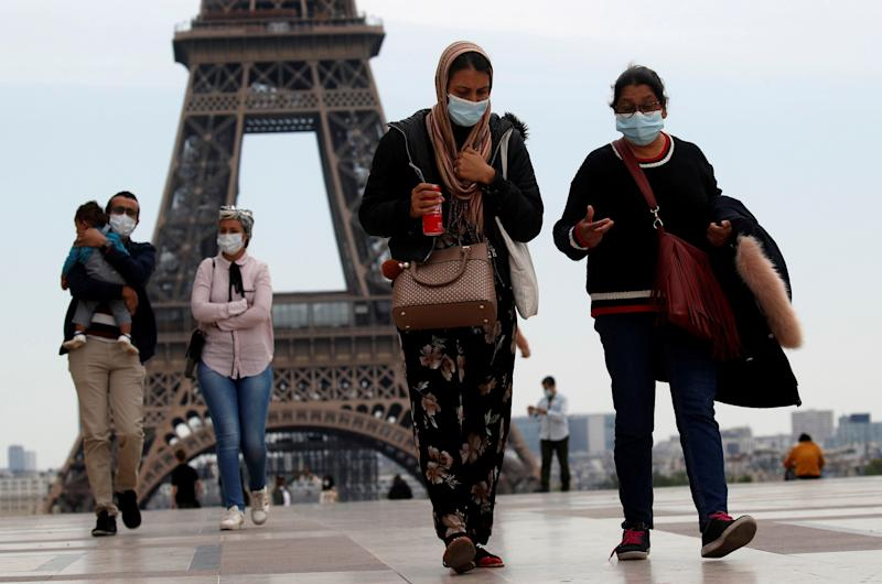People wearing face masks walk at Trocadero square near the Eiffel Tower, as France began a gradual end to a nationwide lockdown due to the coronavirus disease (COVID-19) in Paris, France, May 16, 2020. REUTERS/Gonzalo Fuentes TPX IMAGES OF THE DAY (Photo: Gonzalo Fuentes / Reuters)