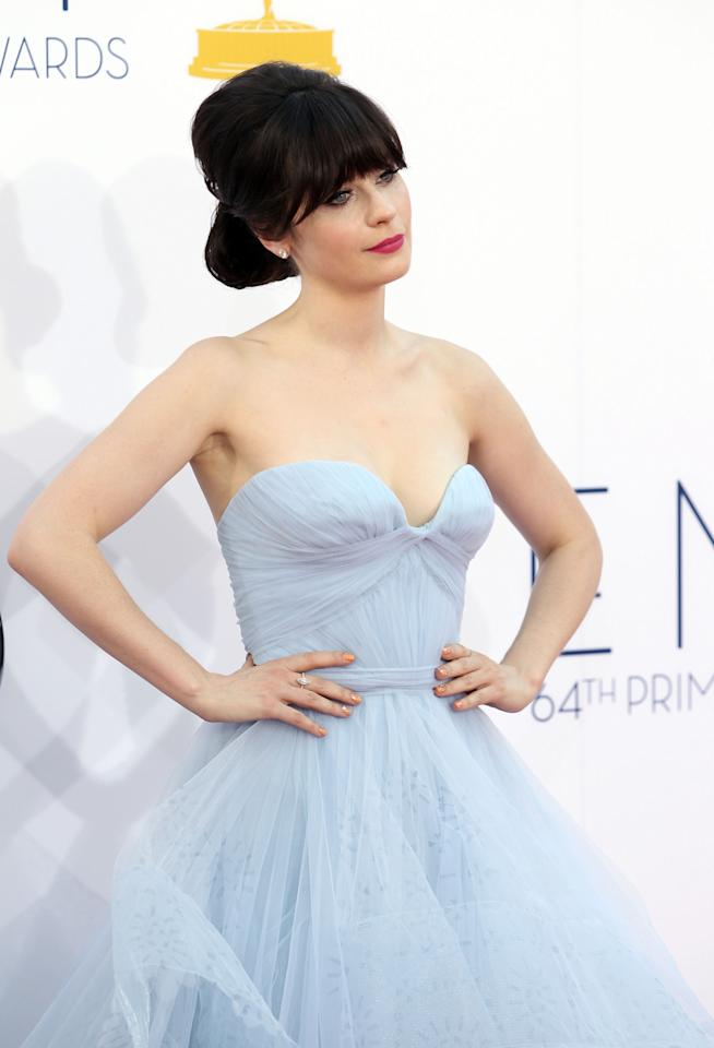 Zooey Deschanel arrives at the 64th Primetime Emmy Awards at the Nokia Theatre on Sunday, Sept. 23, 2012, in Los Angeles. (Photo by Matt Sayles/Invision/AP)