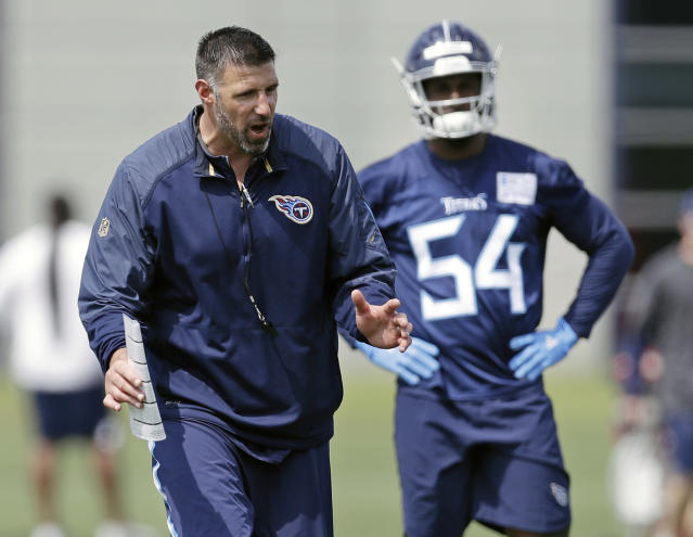 FILE - In this May 12, 2018, file photo, Tennessee Titans head coach Mike Vrabel, left, instructs linebackers including Rashaan Evans (54) during NFL football rookie minicamp in Nashville, Tenn. Vrabel has impressed the Titans and his new coaching staff with his energy and enthusiasm. Now the new head coach faces the challenge of building on his first offseason, and expectations couldn't be much higher. (AP Photo/Mark Humphrey, File)