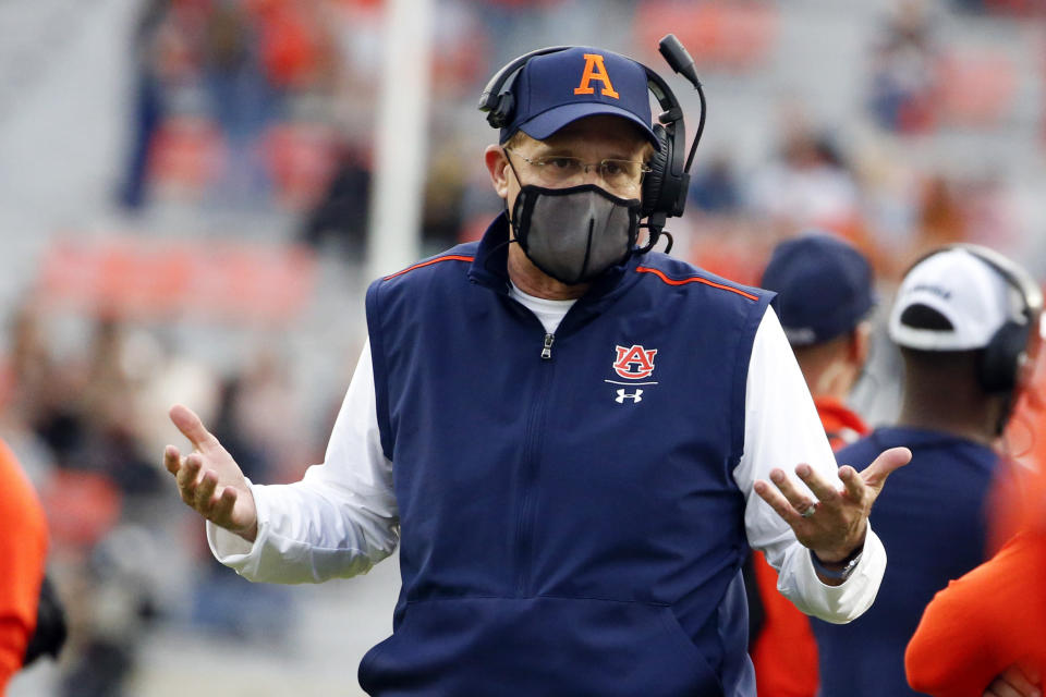 FILE - Auburn head coach Gus Malzahn reacts to a call during the second half of an NCAA college football game against LSU in Auburn, Ala., in this Saturday, Oct. 31, 2020, file photo. Its been a whirlwind three weeks for Auburn, given longtime coach Gus Malzahn getting fired on Dec. 13, new coach Bryan Harsin being introduced 11 days later, several players opting out of the Citrus Bowl and the Tigers hurriedly trying to prepare for a showdown against a stout Northwestern defense. (AP Photo/Butch Dill, File)
