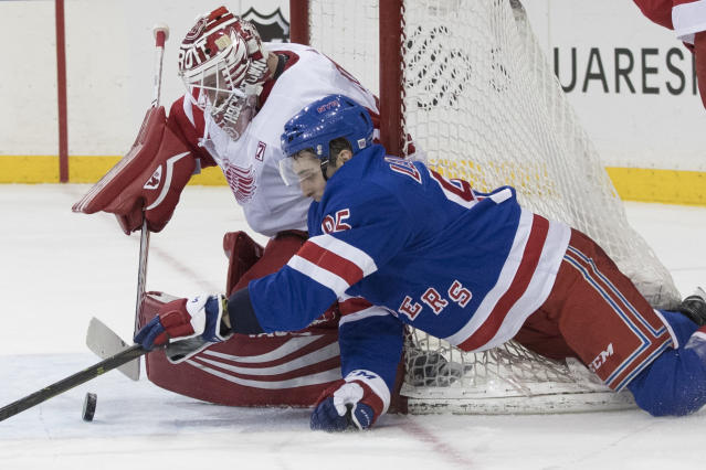Detroit Red Wings goaltender Jimmy Howard (35) makes the save against New York Rangers center Vinni Lettieri (95) during the second period of an NHL hockey game, Tuesday, March 19, 2019, at Madison Square Garden in New York. (AP Photo/Mary Altaffer)