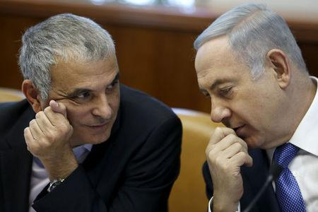 FILE PHOTO: Israeli Prime Minister Netanyahu speaks with Finance Minister Kahlon during the weekly cabinet meeting in Jerusalem
