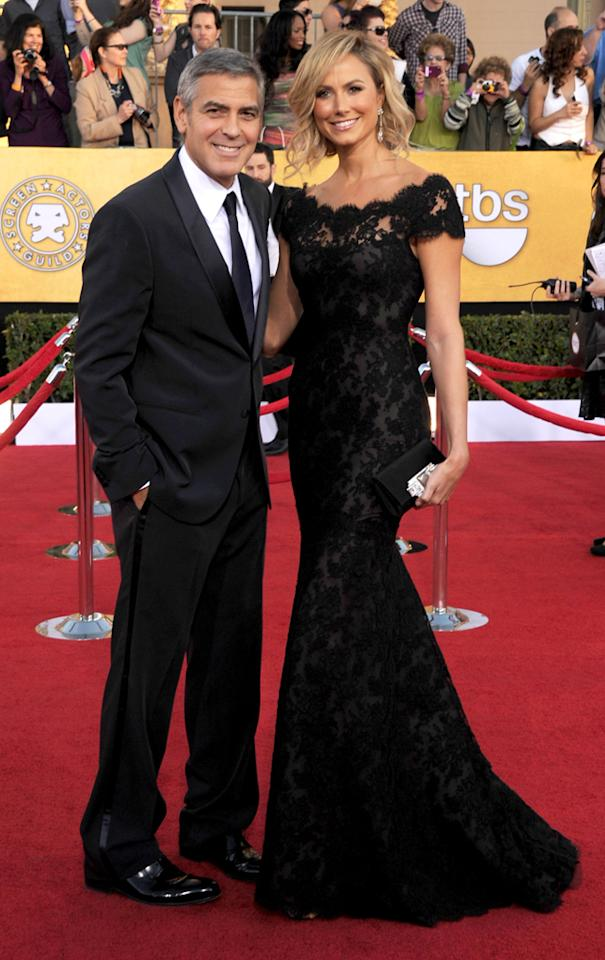 George Clooney and Stacy Keibler (in Marchesa) arrives at the 18th Annual Screen Actors Guild Awards at The Shrine Auditorium in Los Angeles, California.