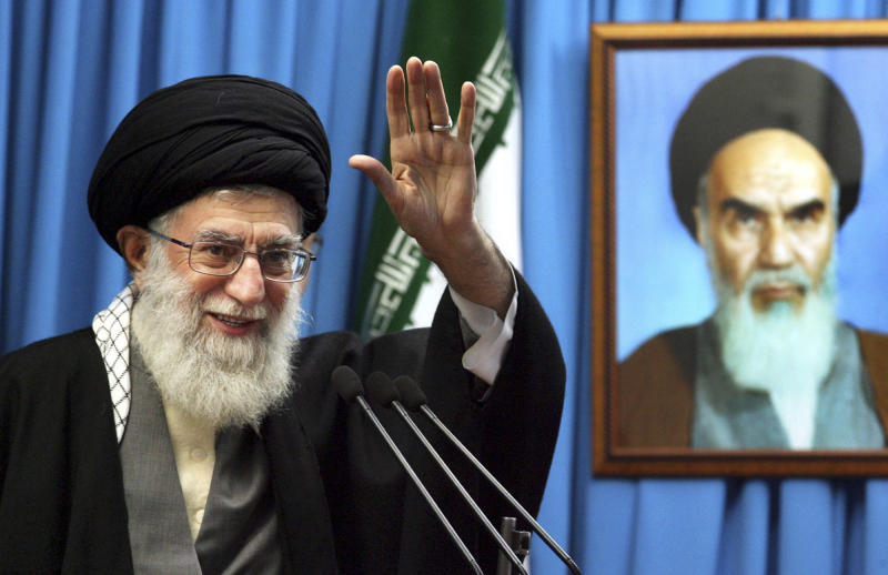 FILE - In this Friday, Feb. 3, 2012 file photo released by an official website of the Iranian supreme leader's office, Iranian supreme leader Ayatollah Ali Khamenei waves to the worshippers, in front of a portrait of the late revolutionary founder Ayatollah Khomeini, before he delivers his Friday prayers sermon, at the Tehran University campus, Iran. Iran's supreme leader Thursday, Feb. 7, 2013 strongly rejected proposals for direct talks with United States, apparently quashing suggestions for a breakthrough dialogue on the nuclear standoff and potentially other issues.(AP Photo/Office of the Supreme Leader, File)