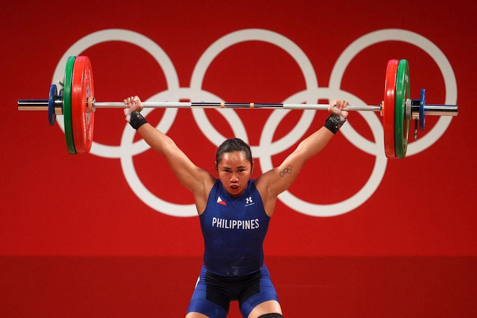 <p>Competing in the women's 55kg weightlifting category, Air Force servicewoman Hidilyn Diaz beat out world-record holder Liao Qiuyun to win the Philippines first ever Olympic gold medal.</p>