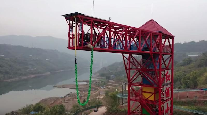 A still of the pig being taken to the edge of the bungee jumping tower. (Photo: Video)
