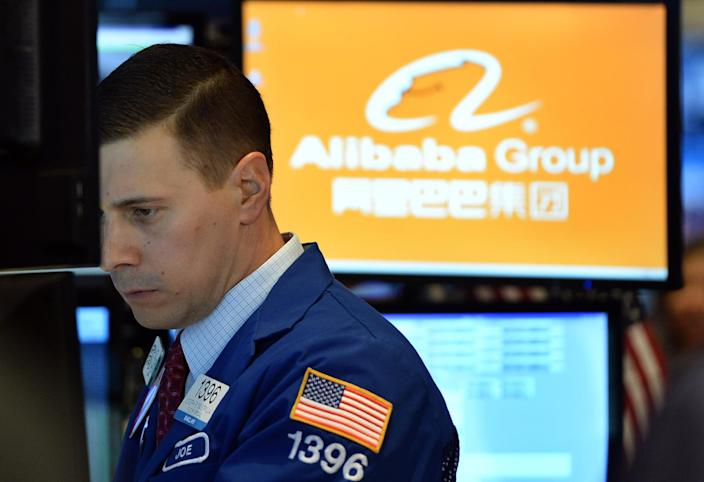 A trader waits for Alibaba's stock to go live on the floor at the New York Stock Exchange on September 19, 2014 (AFP Photo/Jewel Samad)