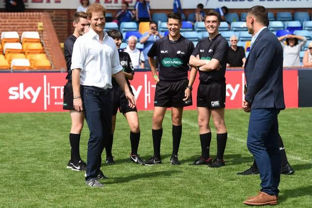 The Duke of Sussex spoke with local players at Headingley in July 2017 as former Leeds star Kevin Sinfield, right, looks on (Paul Ellis/PA)