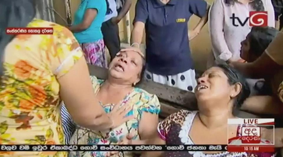 This image made from video, released by Derena TV shows women in despair after hearing of the explosion. Source: AAP