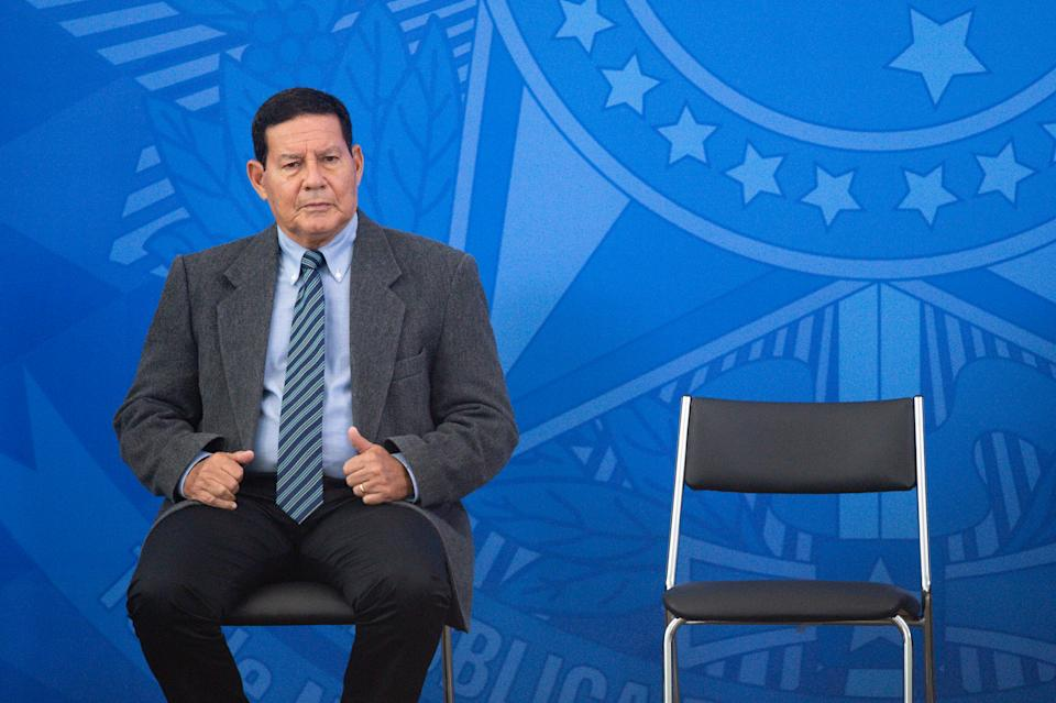 BRASILIA, BRAZIL - APRIL 17: Vice president of Brazil Hamilton Mourão reacts during the sworn-in of newly appointed Health Minister Nelson Teichamidst during coronavirus (COVID-19) pandemic at the Planalto Palace on April, 17, 2020 in Brasilia. President Bolsonaro has fired outgoing Minister of Health Luiz Henrique Mandetta on Thursday 16th over differences in coronavirus strategy. Brazil has over 30,000 confirmed positive cases of Coronavirus and 1956 deaths. (Photo by Andressa Anholete/Getty Images)