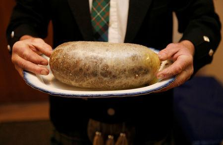 FILE PHOTO: A Haggis is carried at a Burns supper in Killiecrankie, Scotland January 25, 2014. REUTERS/Russell Cheyne/File Photo