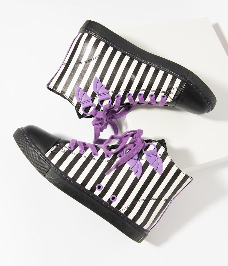 <p>The <span>Black and White Stripe Chelsea Deetz High Top Sneakers</span> ($90) will complete any outfit. </p>