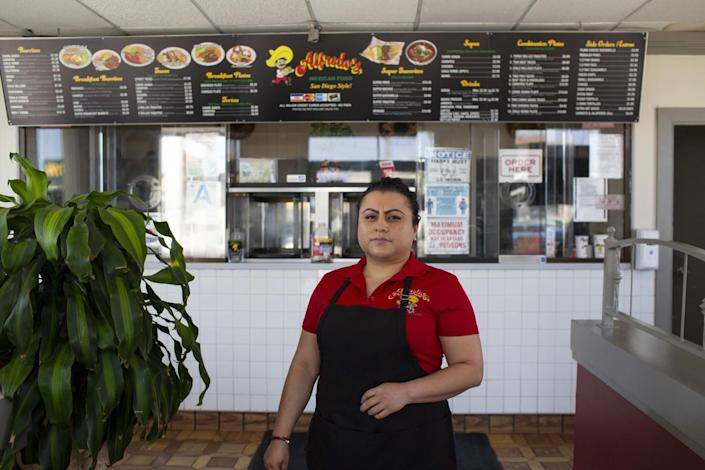 Herminia Reyes stands in front of the order window at Alfredo's Mexican Food