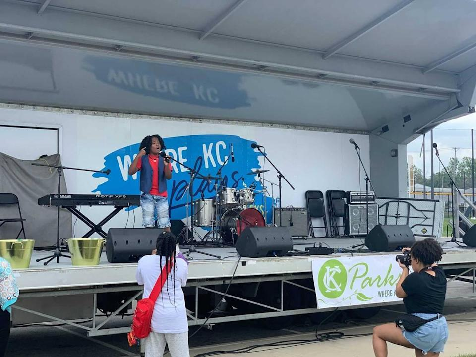 """Troy Sanders, 11, sings """"A Change is Gonna Come,"""" by Sam Cook at the JuneteenthKC Heritage Festival on Saturday, June 19."""