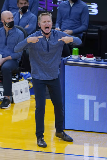 Golden State Warriors coach Steve Kerr yells out to players during the first half of the team's NBA basketball game against the Portland Trail Blazers in San Francisco, Friday, Jan. 1, 2021. (AP Photo/Tony Avelar)