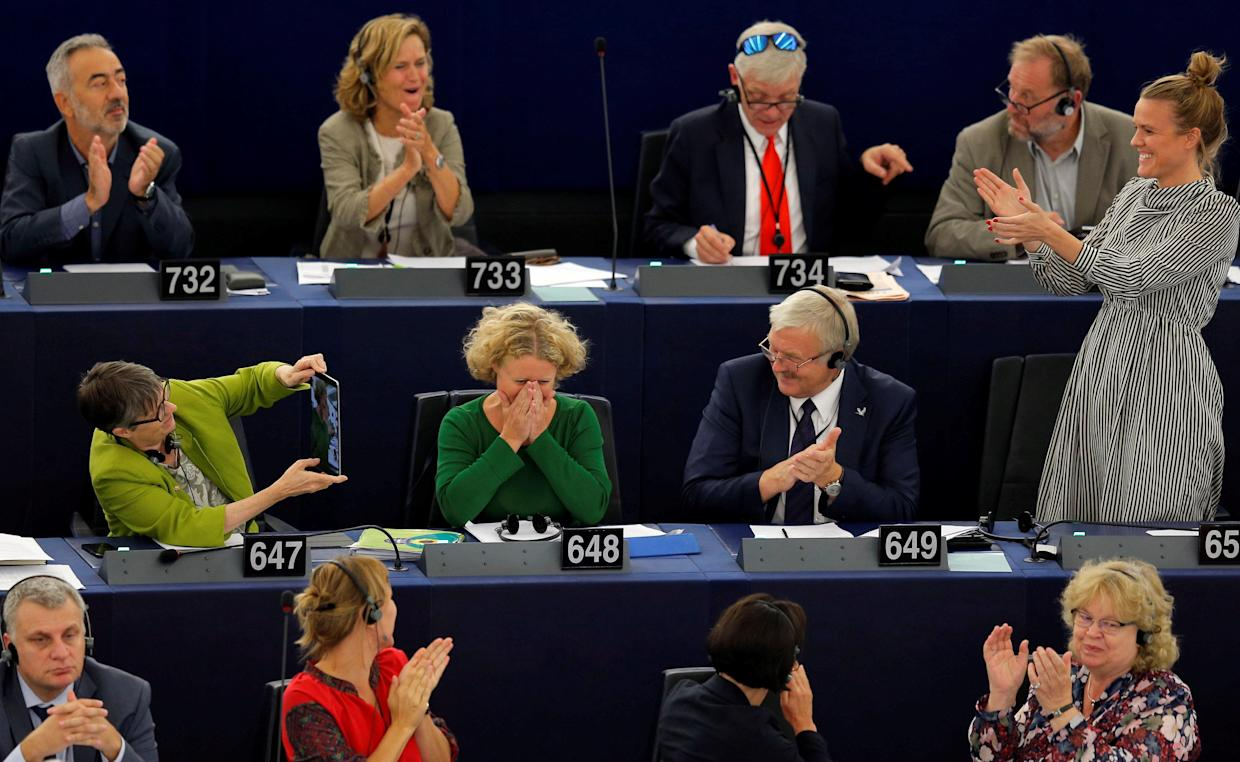 MEPs applaud Judith Sargentini, the Dutch MEP who put forward the censure motion, after the vote (Reuters)
