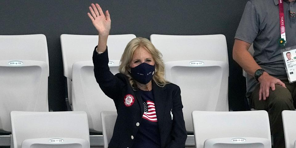 First lady of the United States, Jill Biden waves during a swimming event at Olympics.