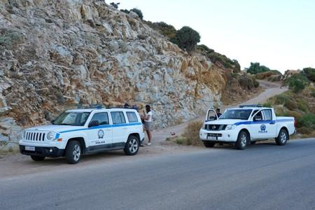 Police officers block the road towards the area where the body of missing 35-year-old British Natalie Christopher was found on the island of Ikaria