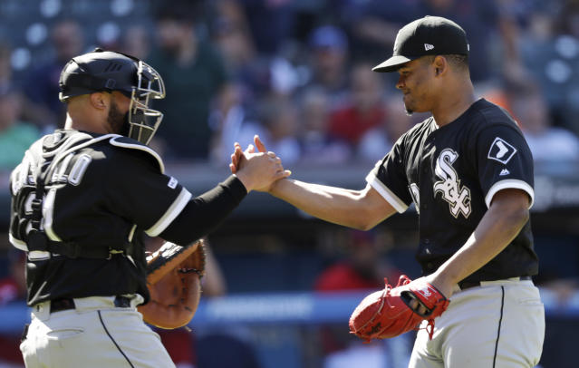 Chicago White Sox starting pitcher Reynaldo Lopez, right, is congratulated by catcher Welington Castillo after they defeated the Cleveland Indians in a baseball game Thursday, Sept. 5, 2019, in Cleveland. (AP Photo/Tony Dejak)