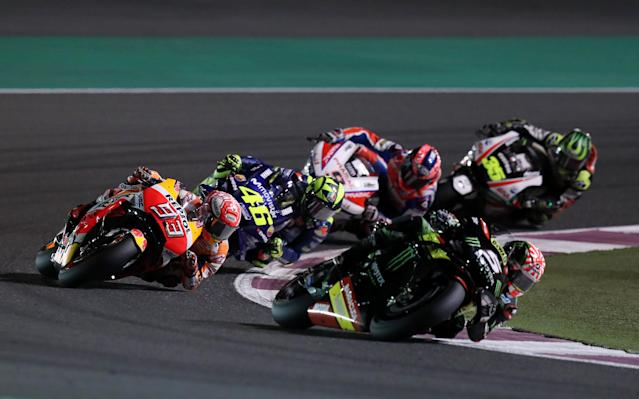 Motorcycle Racing - Qatar Motorcycle Grand Prix - MotoGP race - Losail, Qatar - March 18, 2018 - Repsol Honda Team rider Marc Marquez of Spain, Movistar Yamaha MotoGP rider Valentino Rossi of Italy and Monster Yamaha Tech 3 and rider Johann Zarco of France compete. REUTERS/Ibraheem Al Omari