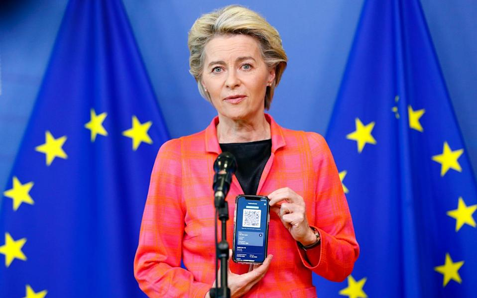 European Commission President Ursula von der Leyen holds a mobile phone as she gives a statement about the EU Digital COVID Certificate in Brussels - JOHANNA GERON/SHUTTERSTOCK