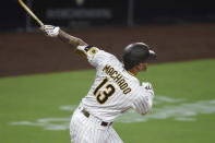 San Diego Padres' Manny Machado hits a two-run home run during the fourth inning of a baseball game against the Seattle Mariners, Friday, Sept. 18, 2020, in San Diego. (AP Photo/Denis Poroy)