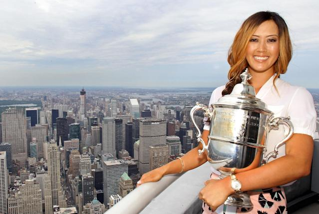 Michelle Wie, winner of the U.S. Women's Open, poses for a photo on the 103rd floor of the Empire State Building on June 24, 2014 in New York (AFP Photo/Adam Hunger)