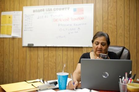 Maria Romano, an organizer for the human rights group Somos Un Pueblo Unidos, speaks on the phone in Hobbs