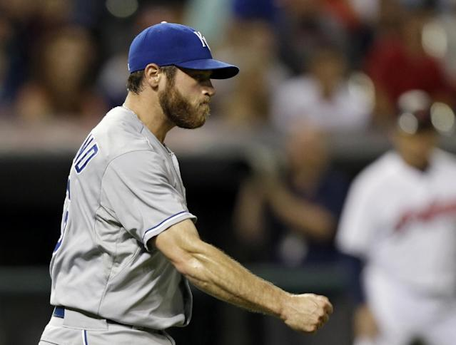 Kansas City Royals relief pitcher Greg Holland celebrates after the final out in a 2-1 win over the Cleveland Indians in a baseball game Monday, June 17, 2013, in Cleveland. (AP Photo/Mark Duncan)