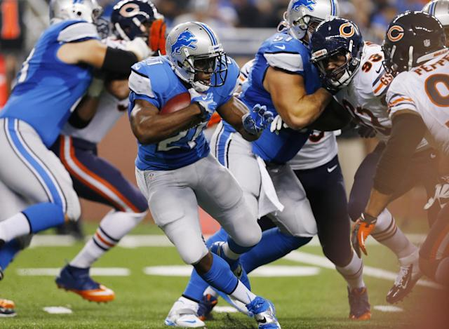 Detroit Lions running back Reggie Bush (21) runs during the first quarter of an NFL football game against the Chicago Bears at Ford Field in Detroit, Sunday, Sept. 29, 2013. (AP Photo/Paul Sancya)