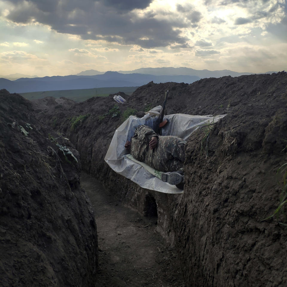 In this image released by World Press Photo, Thursday April 15, 2021, by Vaghinak Ghazaryan, tittle Resting Soldier, which won the third prize in the Contemporary Issues Singles category shows a soldier who lies in a trench, resting on a plastic cover, in the northeastern part of Syunik, Nerkin Khndzoresk, Armenia, on 31 October 2020. (Vaghinak Ghazaryan, World Press Photo via AP)